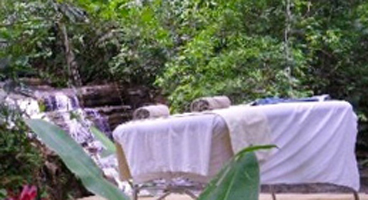Massage table setup in nature preserve setting.